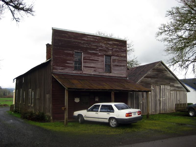 by: NEWS-TIMES PHOTO: HARVEY BERKEY - If it werent for the car parked in front, this old blacksmiths shop still standing where a town once called Glencoe used to sit would like as it did more than 100 years ago.
