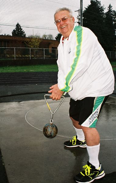 by: PHOTO BY JOHN DENNY - Tossing a 25-pound weight 30 feet is nothing for 80-year-old Wayne Sabin of Milwaukie. Sabin, who works out on a regular basis, won two national titles in the weight events and set a national age-group record in the super-weight throw at the USA Track and Field Masters Indoor Championships, held last month in Boston.