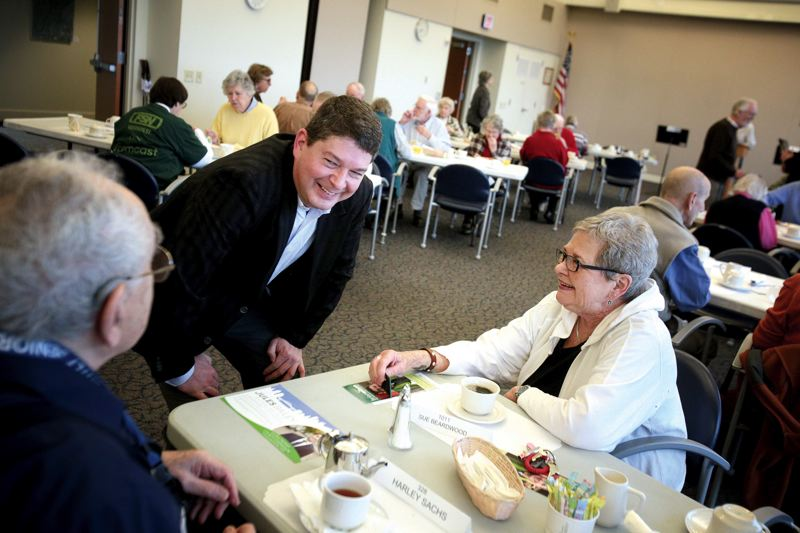 by: TRIBUNE PHOTO: JONATHAN HOUSE - Multnomah County Commission District 1 candidate Brian Wilson chats with Harley Sachs and Sue Beardwood prior to the start of a debate at the Terwilliger Plaza Retirement Community on Saturday.
