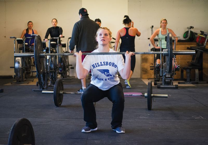 by: HILLSBORO TRIBUNE PHOTO: CHASE ALLGOOD - Hillsboro junior Anna Dean has incorporated CrossFit training into her workout regimen as she prepares to defend her 100-meter hurdles state championship on the track this spring.