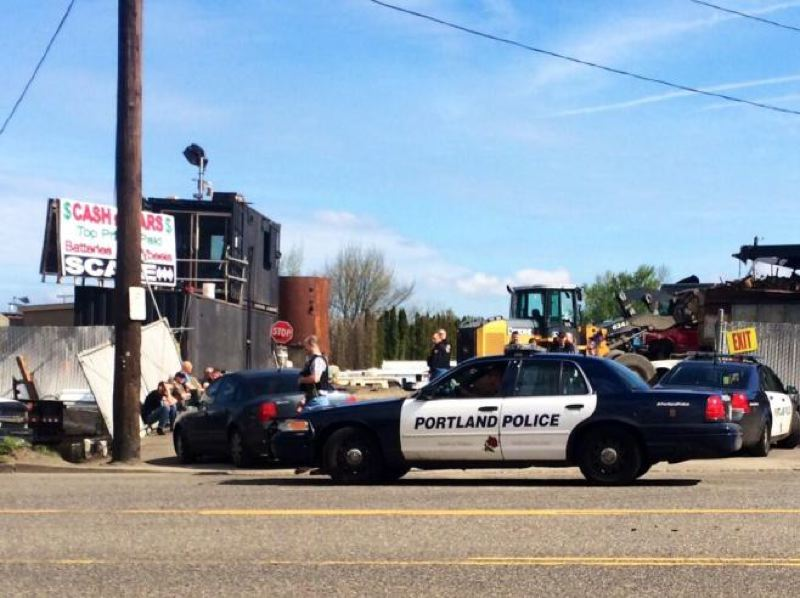 by: KOIN NEWS 6 - Portland police vehicles parked outside the car crushing business under investigation.