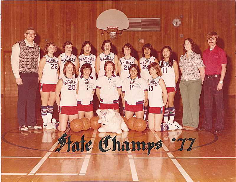 by: PIONEER FILE PHOTO - Members of the Madras High School 1977 girls basketball pose with a stuffed White Buffalo the team used to travel with. This group of players brought home the school's first girls state basketball title with an impressive run 37 years ago.
