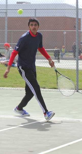 by: JEFF WILSON/THE PIONEER  - MHS' Simon Sangha returns a shot during Saturday's tourney.