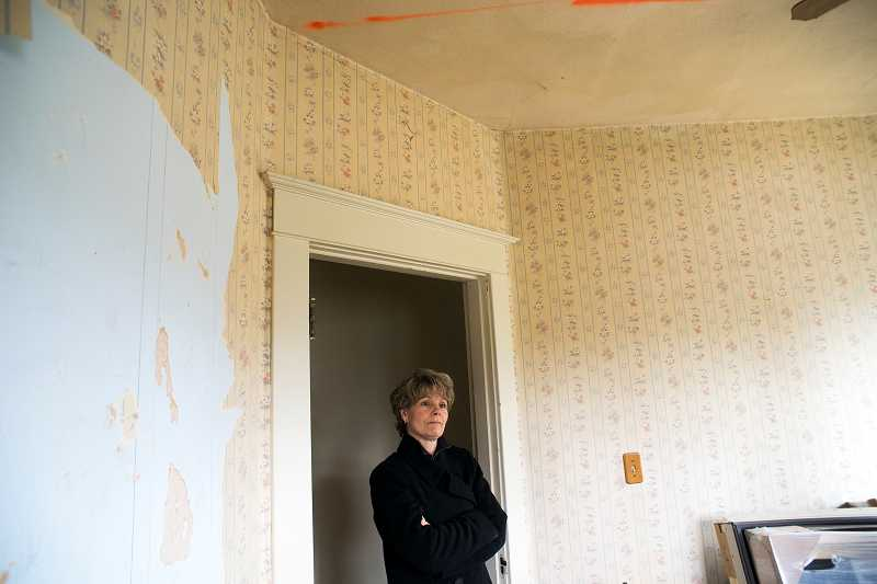 by: NEWS-TIMES PHOTOS: CHASE ALLGOOD - We just love this town, Susan Brown says of Forest Grove, where she and her husband, Barrett Brown, are working to restore a 1912 bungalow they bought last year. The couple currently lives outside Mountaindale.