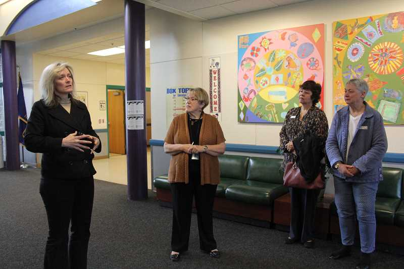 by: LINDSAY KEEFER - Heritage Elementary co-principals Sherrilynn Rawson (from left) and Irene Novichihin lead a tour of the school for community members, including Lin Reeves and Connie Lum.
