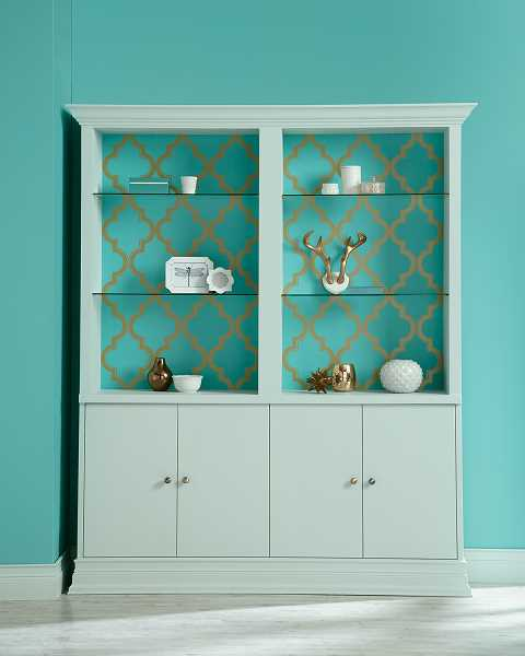 by: SUBMITTED PHOTOS - This china cabinet is painted in Devine Color Pond; a matching wallpaper is used on the back of the cabinet.