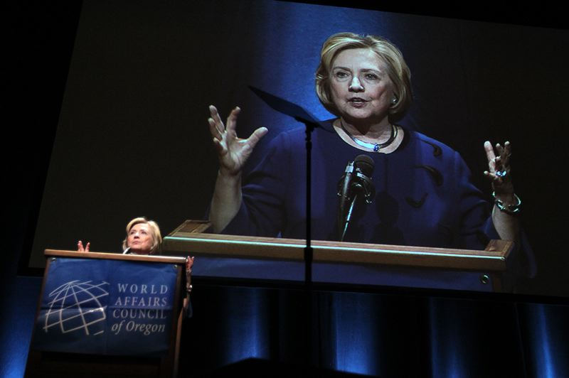 by: TRIBUNE PHOTO: JONATHAN HOUSE - Former First Lady Hillary Clinton praised Oregon's equal rights amendment proposal, and Portland's Voodoo Doughnuts during her 90-minute speech to the World Affairs Council Tuesday night at Keller Auditorium.