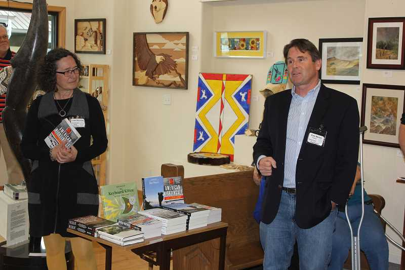 by: SUSAN MATHENY/MADRAS PIONEER - Author Bob Welch comments on his books during Friday night's reception at Art Adventure Gallery. Community Read committee member Lisbet Hornung, on left, introduced him.