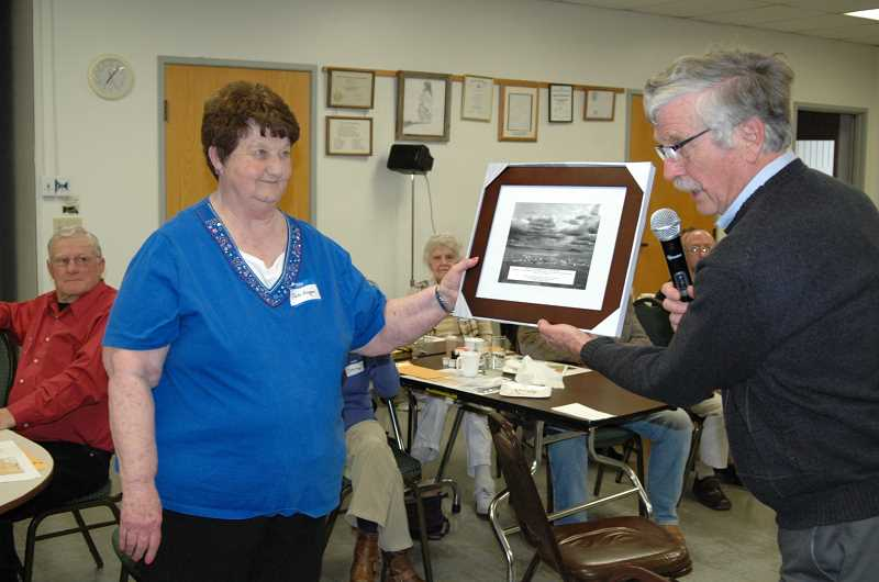 by: SUSAN MATHENY/MADRAS PIONEER - Jodi Eagan is presented with the Beth Crow Award by historical society president Jerry Ramsey.