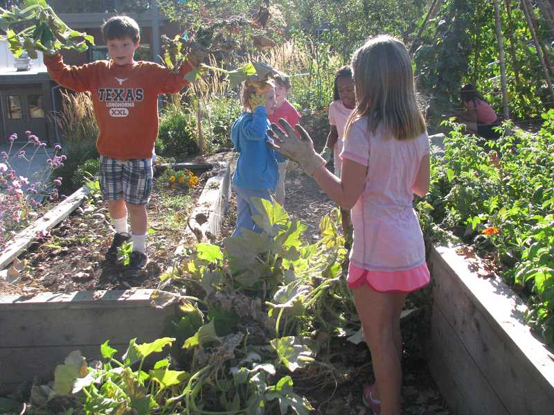 by: SUBMITTED PHOTO - Bolton students like fifth-grader Oliver Chapdelaine, left, use the schools garden for outdoor fun and learning.
