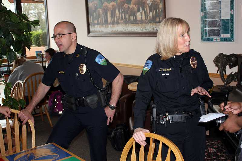 by: NEWS-TIMES PHOTO: DOUG BURKHARDT - With all the police officers in BJs Coffee last Wednesday morning, it could have been a crime scene- - except for the smiles. Im pretty thrilled, said Forest Grove Police Chief Janie Schutz, who led the departments inaugural Coffee With a Cop. The event drew compliments, questions and friendly hellos from Forest Grove residents.