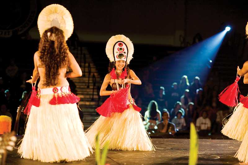 by: NEWS-TIMES FILE PHOTO - Hula dancing and traditional music make Pacific Universitys luau an authentic experience.