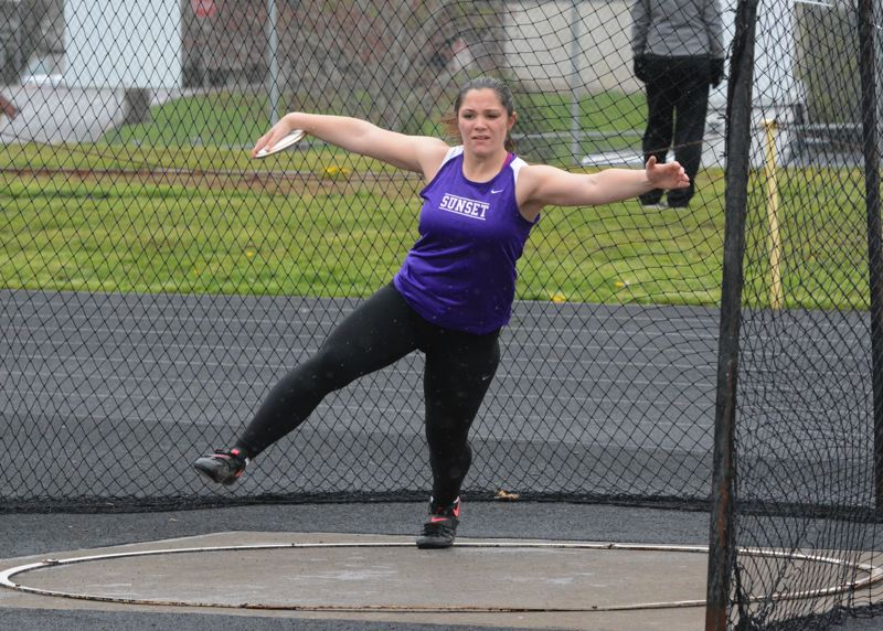 by: TIMES PHOTO: MATT SINGLEDECKER - Sunsets Savannah Sharp won both the discus and shot put at the Apollos dual meet with Southridge on Thursday. Sharp set a new personal record in the shot.