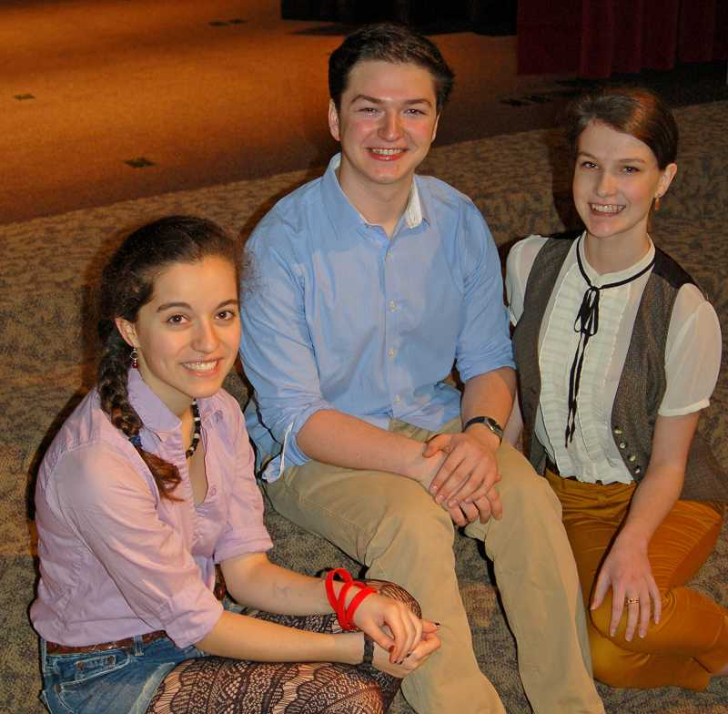 by: SUBMITTED PHOTO: AMY HAROLDSON - Steve Rathje, center, relaxes with his cast members, from left: Isabel Skene and Ruby King.