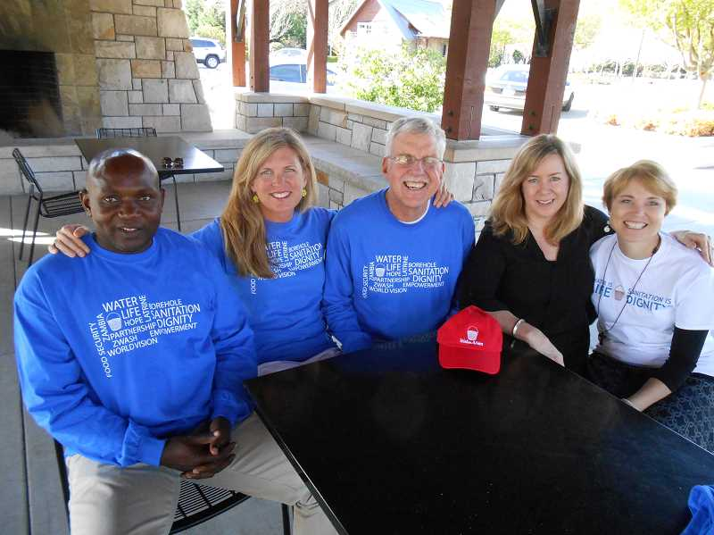 by: REVIEW PHOTO: CLIFF NEWELL - Sebastian Kunda of Zambia is the guest of honor for Walk4Water7 on Saturday. From left are Kunda and event committee members Linda Favero, Bill Savage, Sharon Reichle and Mary Austin.