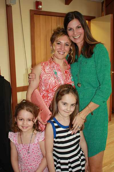 by: SUBMITTED PHOTO: LAUREN HUGHES - Runway on the Lake emcee Hayley Platt, right, has a big hug of congratulations for Kelly Calabria and her daughters Penny, left, and Maria, who were models for the event.