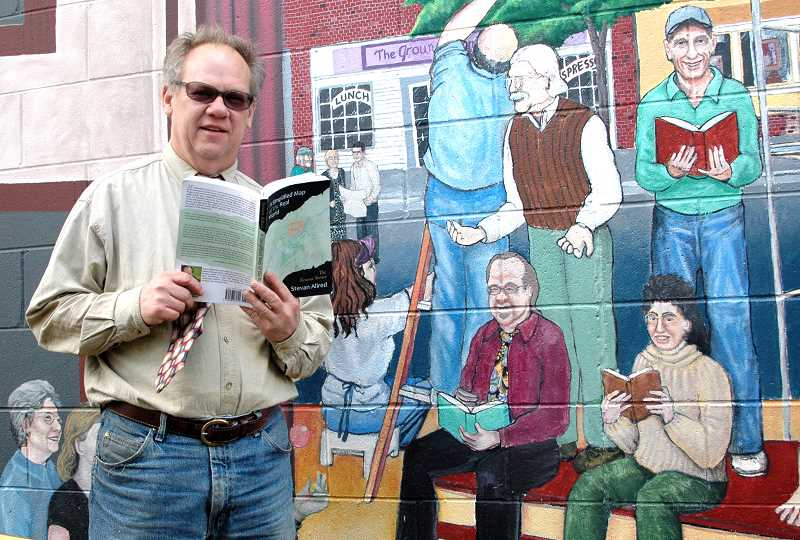 by:  ISABEL GAUTSCHI - Allred may have immortalized a fictional version of Estacada in 'A Simplified Map of the Real World,' but the town also has immortalized him. Allred stands by a portrait of himself in Joe Cotter's 'All the World's A Stage' Artback Mural painted on the Hi-School Pharmacy wall.
