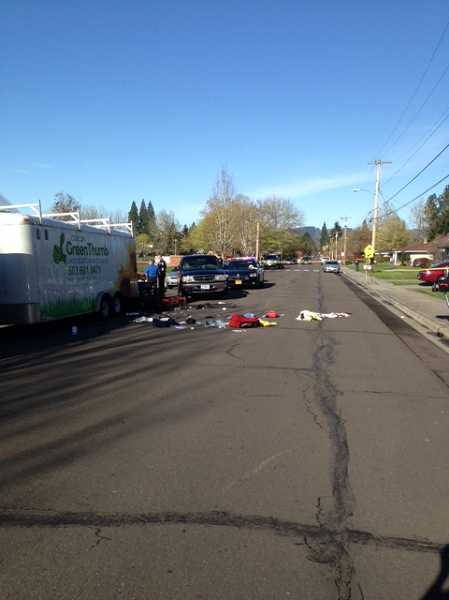 by: COURTESY PHOTO: FOREST GROVE POLICE DEPARTMENT - By 9:30 a.m., the accident site was still littered with a blanket, medical-supply backpacks, jeans with the belt still in them and a pair of black shoes.
