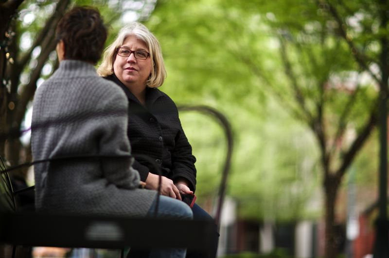 by: TRIBUNE PHOTO: JAIME VALDEZ - Susan Lehman, a Portland Police Bureau advocate for sex assault victims, talks with a former homeless woman who has been victimized several times on the streets.