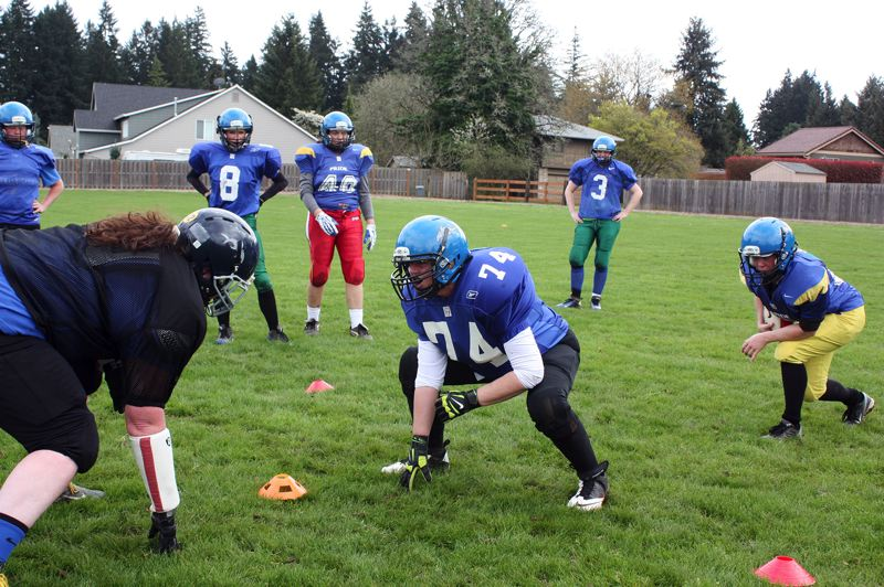 by: HILLSBORO TRIBUNE PHOTO: DOUG BURKHARDT - Members of the Hammerheads take turns practicing the Oklahoma Drill, which calls for a runner to get through the defense with a single blocker leading the way. Head coach Beth Buglione says the drill is the closest to a live game I can give in practice.