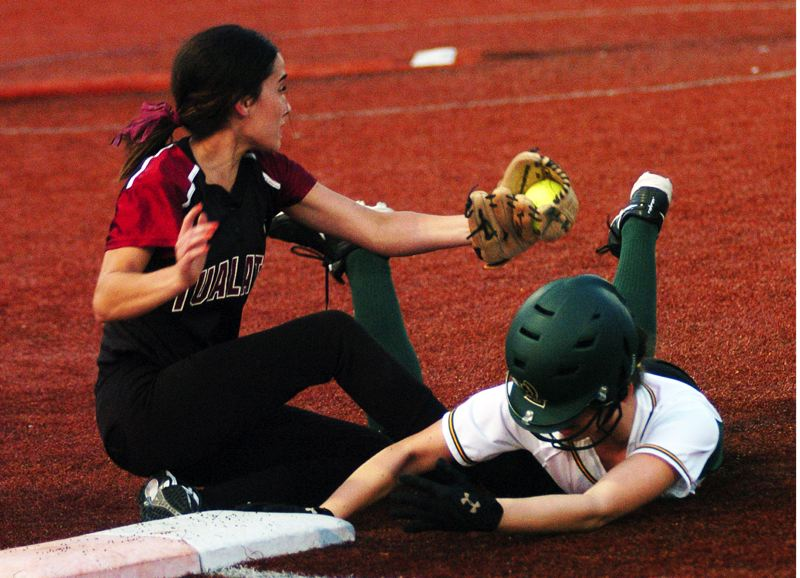 by: DAN BROOD - YOU'RE OUT -- Tualatin senior second baseman Beth Fanger (left) tagged out West Linn's Lisa Reavely to complete a fifth-inning double play in Monday's game. The Wolves won 6-0.