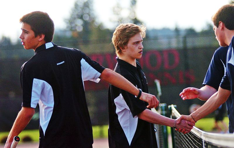 by: DAN BROOD - WINNERS -- Sherwood's Chad Voydat (left) and Kyle Hern meet with their Canby oppenents after scoring a win in No. 1 doubles play in last week's match.