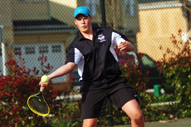 by: DAN BROOD - WINNING FORM -- Sherwood High School senior Anders Joergensen hits a shot during his 6-2, 6-0 win over Canby's Austin Evans in No. 1 singles play last week.