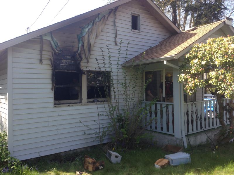 by: COURTESY OF PFR - One man died Thursday, April 10, in a fire that damaged a Southwest 61st Avenue home. Firefighters were confronted by piles of clutter when they went into the house to find the victim.