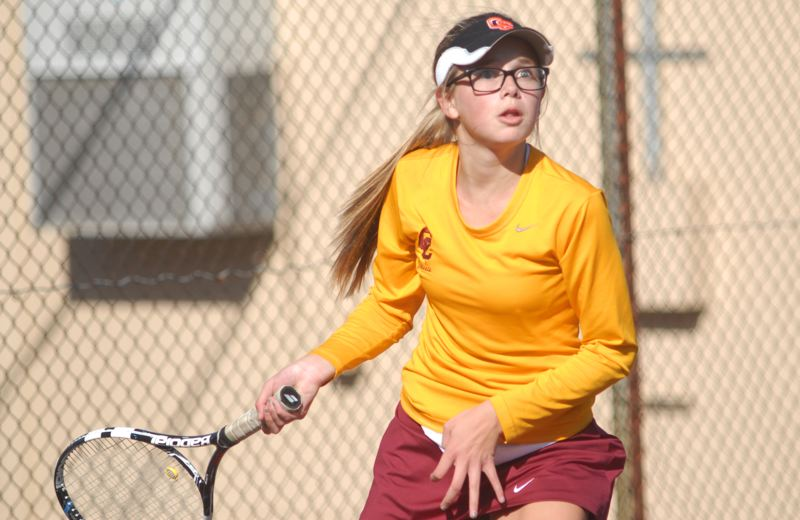 by: PAMPLIN MEDIA GROUP: DAVID BALL - Central Catholics Julia Johnson makes a forehand return on her way to a 6-2, 6-3 win in No. 2 singles Wednesday.