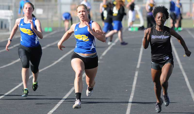 by: LON AUSTIN/CENTRAL OREGONIAN - Elsa Harris races past Ridgeview's Hannah Steigman and Crook County's Audrey Bernard to win the 100-meter dash in a school record time of 12.778.