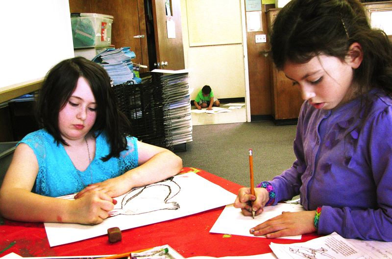 by: OUTLOOK PHOTO: LISA K. ANDERSON - Hailey De Leon, right, draws a tree boa. She says she loved learning how to use pastels.