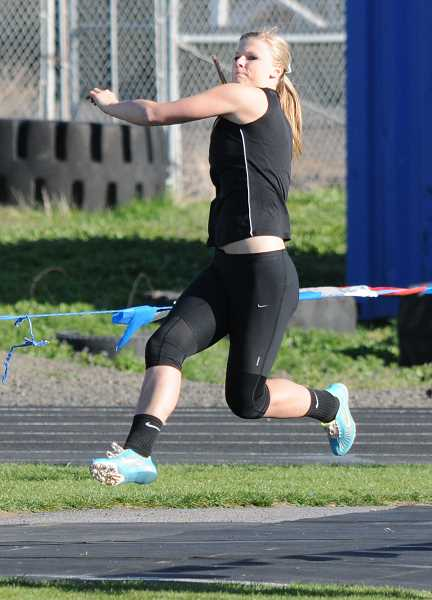 by: LON AUSTIN/CENTRAL OREGONIAN - Hannah Troutman throws the javelin 130-09 to set a school record and win the event as the Cowgirls defeated the Ravens 93.5-79.5.