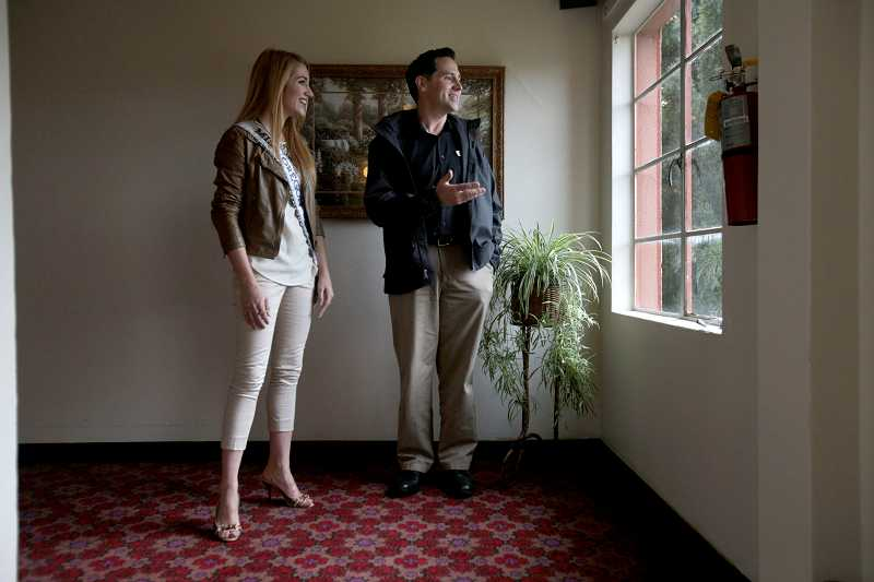 by: TIMES PHOTO: JONATHAN HOUSE - Miss Oregon Emma Pelett gets a tour of the new Union Gospel Mission LifeChange Center in Beaverton on Friday from Pastor Rob Howells.