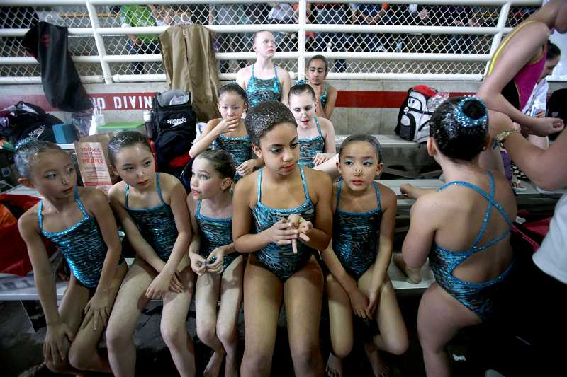 by: TIMES PHOTO: JONATHAN HOUSE - Seattle Synchro Team swimmers wait for their turn to perform.