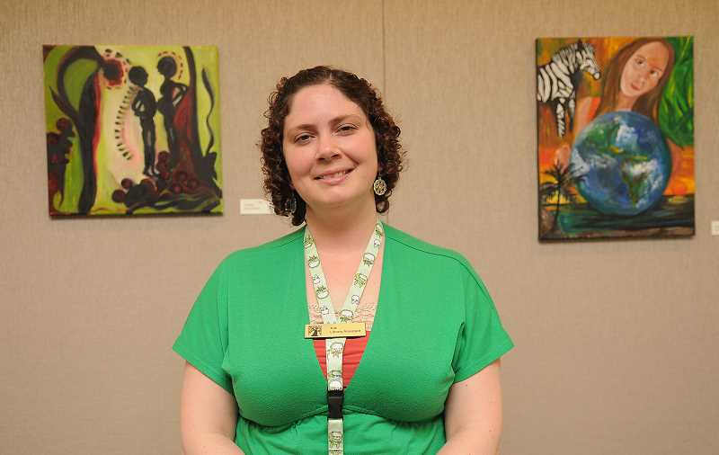 Library assistant Kali Cardenas has two paintings in the show.
