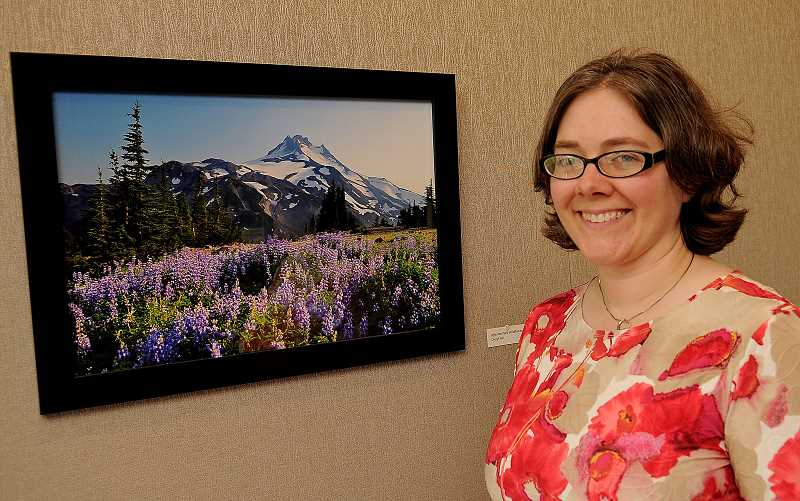 Adult Services librarian Cheryl Hill is exhibiting a photograph she took in Jefferson Park Wilderness area.