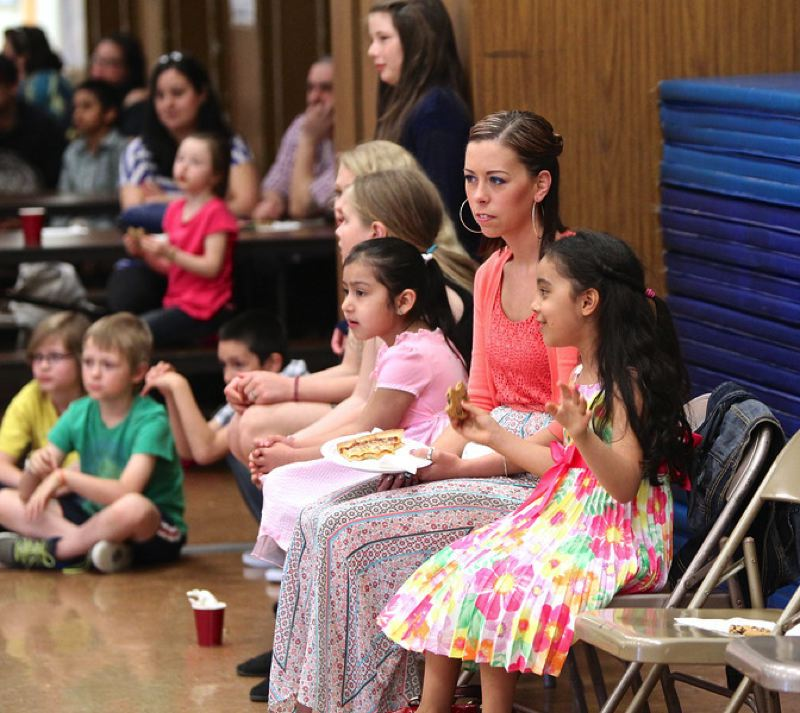 by: PHOTO COURTESY: BRAD CANTOR - Parents and students watching Arthur Murray dancers give demonstration.