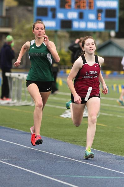 by: HILLSBORO TRIBUNE PHOTO: AMANDA MILES - Glencoe sophomore Sabrina McGowen leads Summit's Claire Parton to the finish line in the freshman/sophomore 800 meters last Saturday.