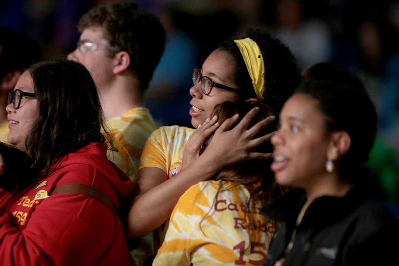 by: TIMES PHOTO: JONATHAN HOUSE - Catlin Gabel's Eve Maquelin watches with nervous excitement as her team competes during the Pacific Northwest FIRST Robotics District Championship on Friday.