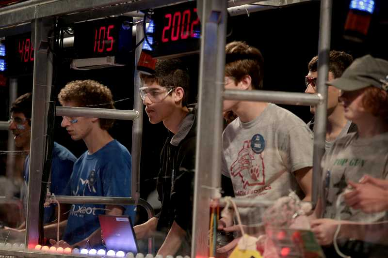 by: TIMES PHOTO: JONATHAN HOUSE - Jorge Reyes of the Tualatin Robotics Team drives their robot during the Pacific Northwest FIRST Robotics District Championship.