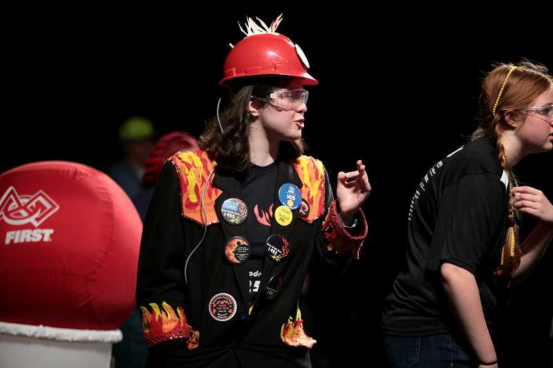 by: TIMES PHOTO: JONATHAN HOUSE - Karen Harper of the West Linn/Wilsonville team, Error Code Xero, gives direction to her drivers during the Pacific Northwest FIRST Robotics District Championship.