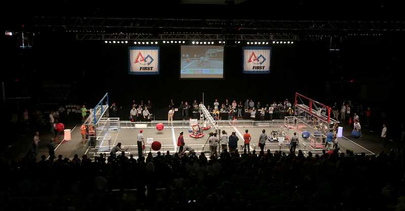 by: TIMES PHOTO: JONATHAN HOUSE - Robots battle to score points using huge balls at the Pacific Northwest FIRST Robotics District Championship.