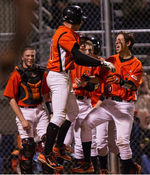 by: DAVID BLAIR - Andrew Gross (10) celebrates Gladstones 6-5 come-from-behind win over Estacada with Ben Fox following last weeks home game with the Rangers.