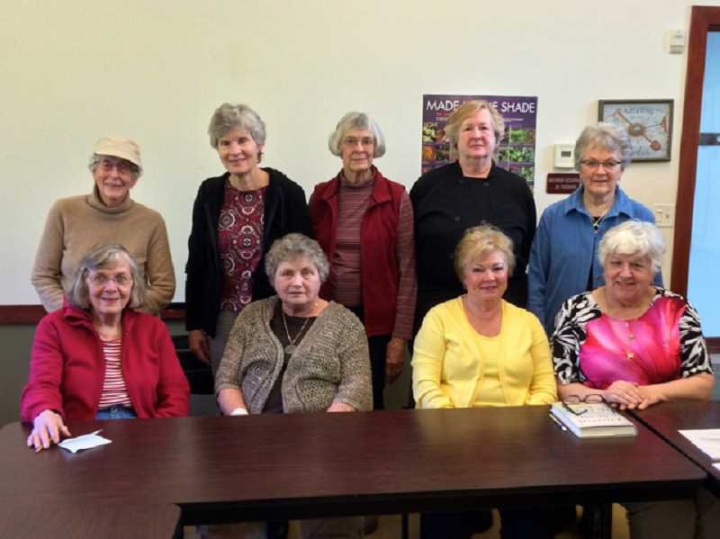 by: SUBMITTED PHOTO - Luella Hunt, pictured at far right in the front row, is the facilitator of the book group at the West Linn Adult Community Center. Posing with her are other members of the group.