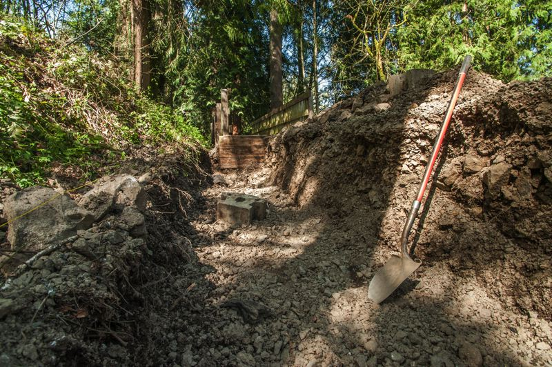 by: SPOKESMAN PHOTO: JOSH KULLA - This trench in the Boeckman Creek Crossing trail will be filled with gabions - thick wire mesh cages filled with stones - are used to control erosion.