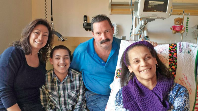 by: SUBMITTED PHOTO - Sylvia Soumokil, far right, is pictured in her hospital room with, from left, her sister Dorothy Wenzel, son Brandon Soumokil-Freer and husband Kevin Freer.
