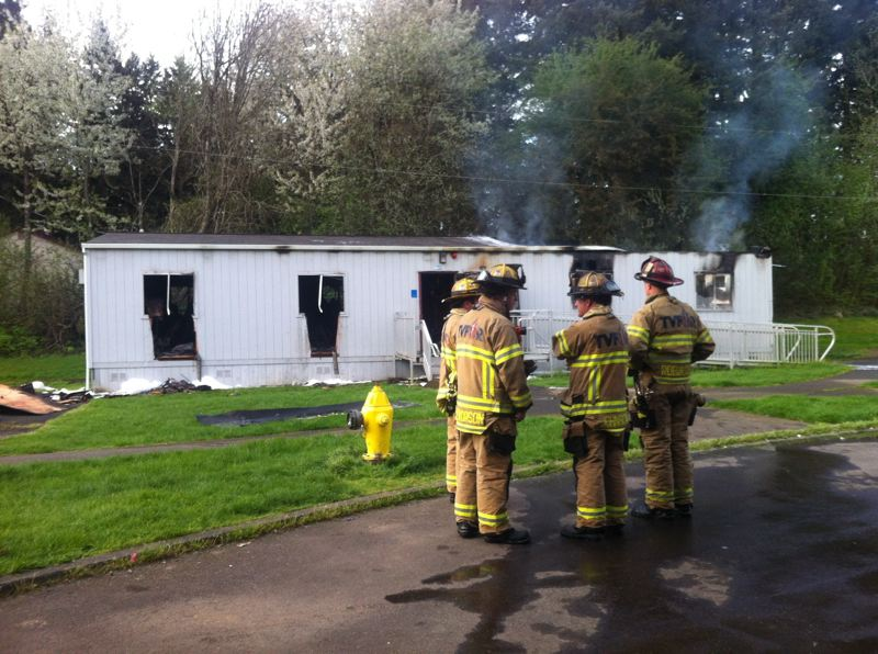 by: TIMES PHOTO: JAIME VALDEZ - Tualatin Valley Fire & Rescue crews remain at Highland Park Middle School following a Tuesday morning fire in a portable building on campus used to store items. An investigation continues into what caused the blaze.