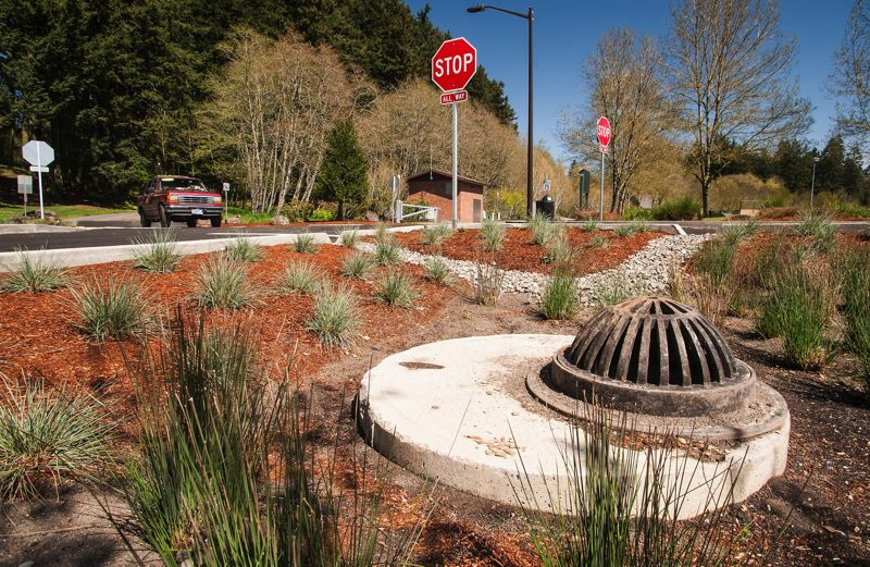 by: SPOKESMAN PHOTO: JOSH KULLA - Bioswales and other stormwater drainage improvements feature heavily in a recently completed overhaul of the parking area at Wilsonvilles Memorial Park. The project was finished last month.