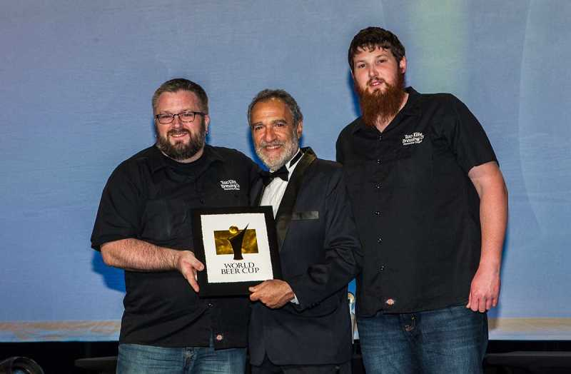by: COURTESY OF JASON E. KAPLAN - Chris Dillon, left, and Alex McGaw receive a gold medal at the World Beer Cup held in Denver for their Scottish Ale brewed at their Two Kilts Brewery in Sherwood.