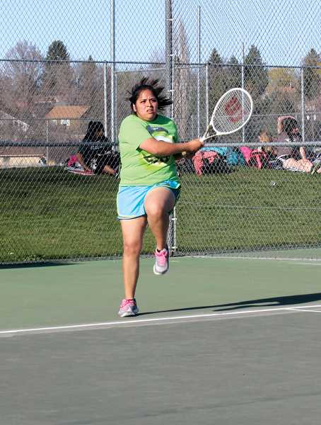 by: JEFF WILSON/THE PIONEER - Madras' Lorena Alonso rips a shot during a match last week against North Marion.